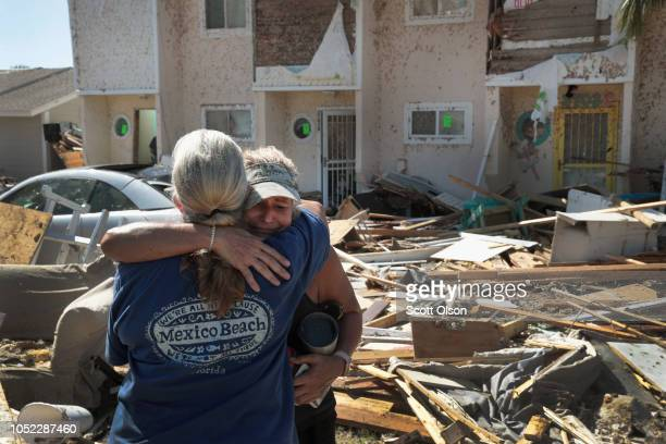 Neighbors Sherry Frantz and Chris McNeal hug as they meet in front of their homes which were destroyed by Hurricane Michael on October 16 2018 in...