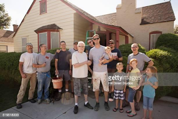 Neighbors smiling outside house