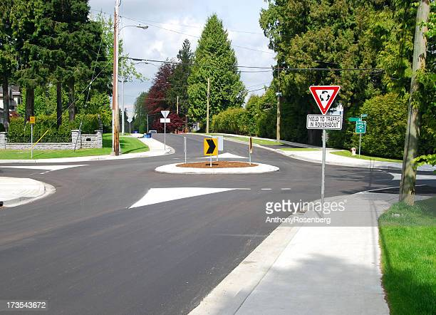 neighbourhood roundabout - give way stock pictures, royalty-free photos & images