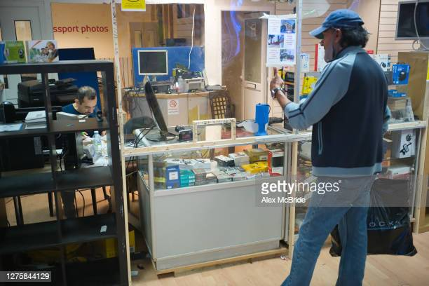 Neighbouring shop manager comes to say his goodbyes at Tech Room in Elephant & Castle Shopping Centre in Elephant & Castle on September 23, 2020 in...