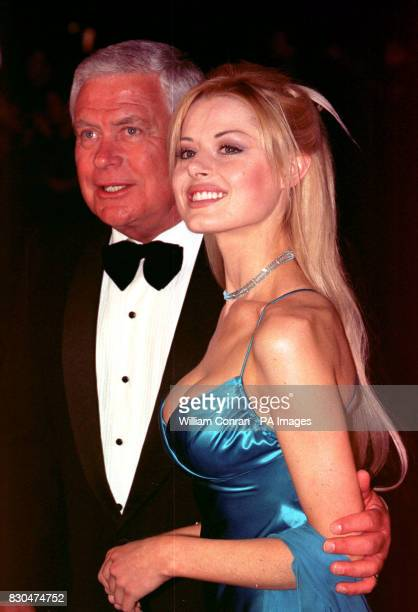 Neighbours actor Tom Oliver who plays Lou Carpenter and Madeleine West who plays Dione Bliss arrives at the National Television Awards 2000 at the...