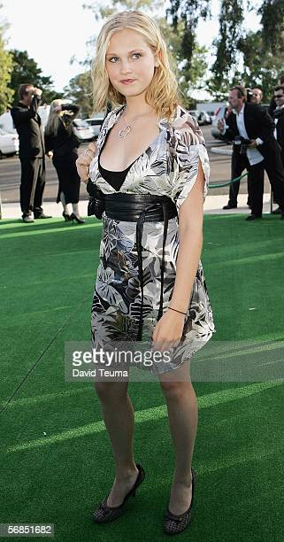 Neighbours actress Eliza TaylorCotter poses on the green carpet during the Miss Green Valentines Day party at Carousel on February 14 2006 in...