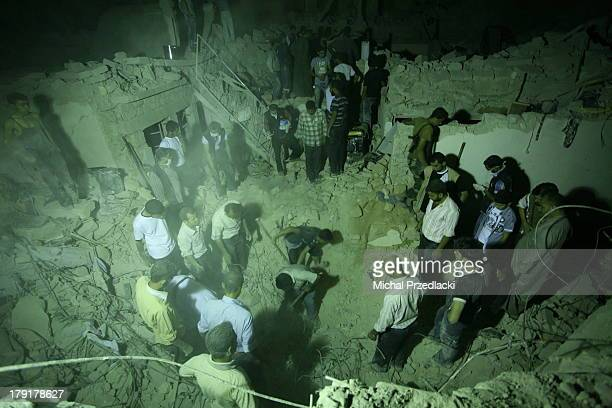 CONTENT] Neighbours and volunteer rescuers search through rubbles of destroyed buildings in Bab Al Nairab Aleppo On Friday 26th July 2013 several...