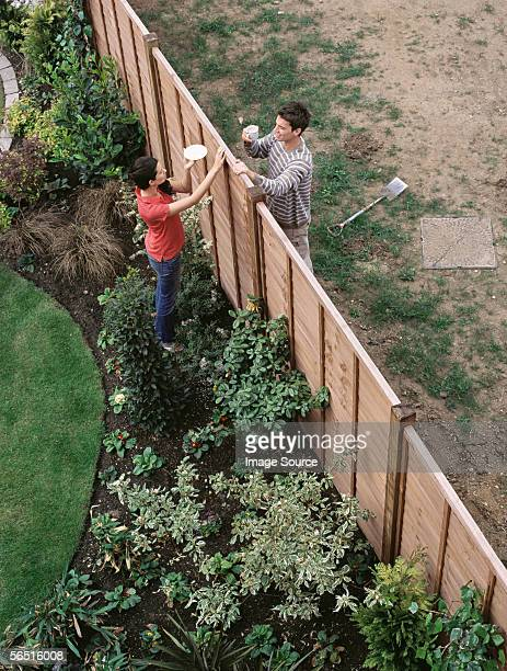 Neighbours having coffee over the fence