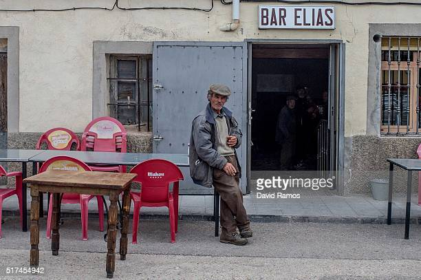 Neighbours of Hiendelaencina looks on outside a bar ahead of the reenactment of Christ's suffering on March 25, 2016 in Hiendelaencina, Spain. The...