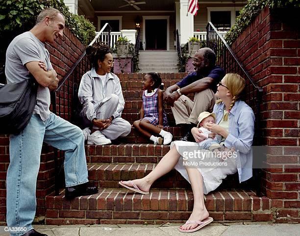 Neighbours talking on steps