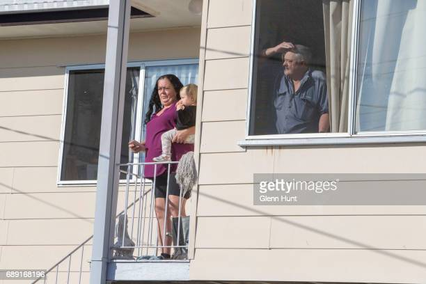 Neighbours watch a TV helicopter over head near the house of Schappelle Corby's mother in Loganlea on May 28 2017 in Brisbane Australia Schapelle...