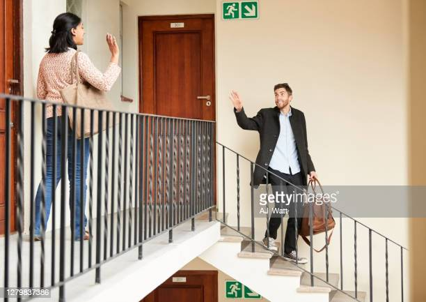 neighbours waving to each other while going to work - neighbour stock pictures, royalty-free photos & images