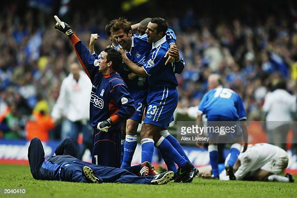 Neil Alexander Gary Croft and Chris Barker of Cardiff City celebrate promotion as the final whistle blows during the Nationwide League Division Two...
