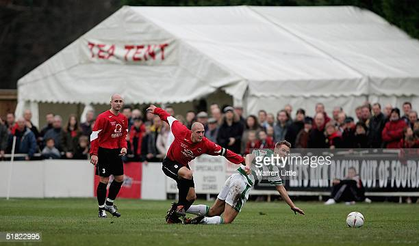Neil Andrews of Histon tackles Bartos Tarachulski of Yeovil during the FA Cup second round match between Histon FC and Yeovil Town FC at the...