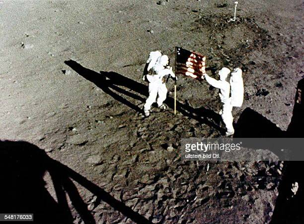 Neil Armstrong and Buzz Aldrin raise the American Flag on the Moon NO COMMERCIAL USE