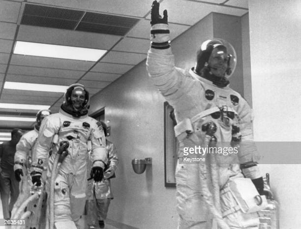 Neil Armstrong leads Edwin 'Buzz' Aldrin and Michael Collins out of the space centre on the Apollo 11 space mission to the moon