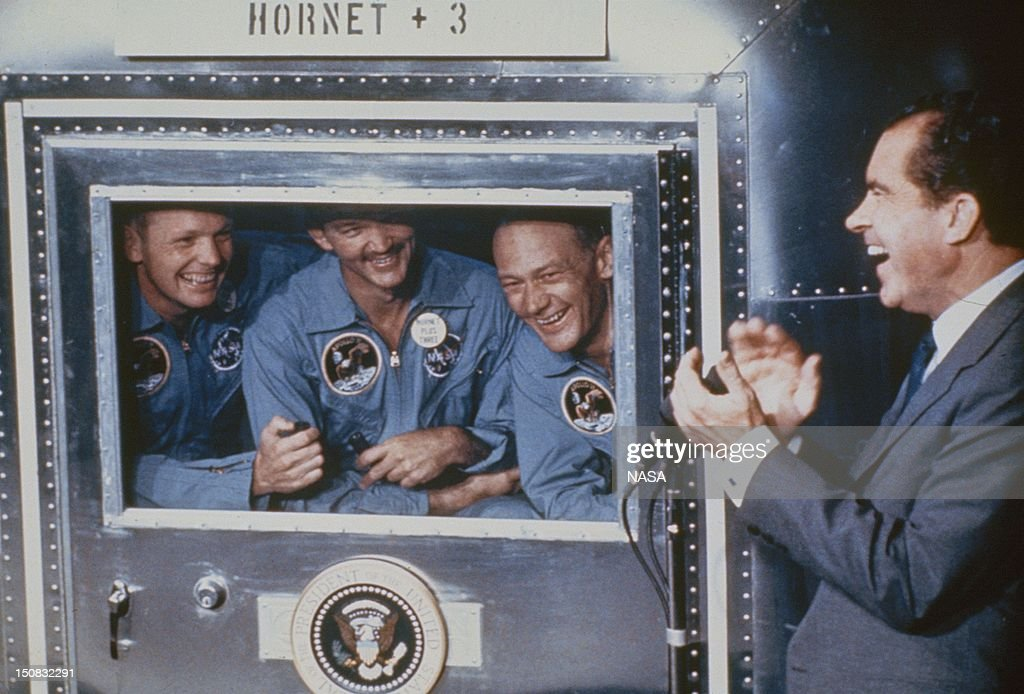 Neil Armstrong, Michael Collins and Edwin Aldrin, the crew of the historic Apollo 11 moon landing mission, who are are subjected to a period of quarantine upon their return to earth, hold a conversation with President Richard Nixon in the United States on July 24, 1969.