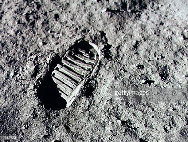 Neil Armstrong steps into history July 20 1969 by leaving the first human footprint on the surface of the moon The 30th anniversary of the Apollo 11...