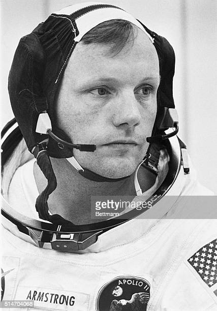 Neil Armstrong, the first person to walk on the moon, wears an Apollo mission space suit.