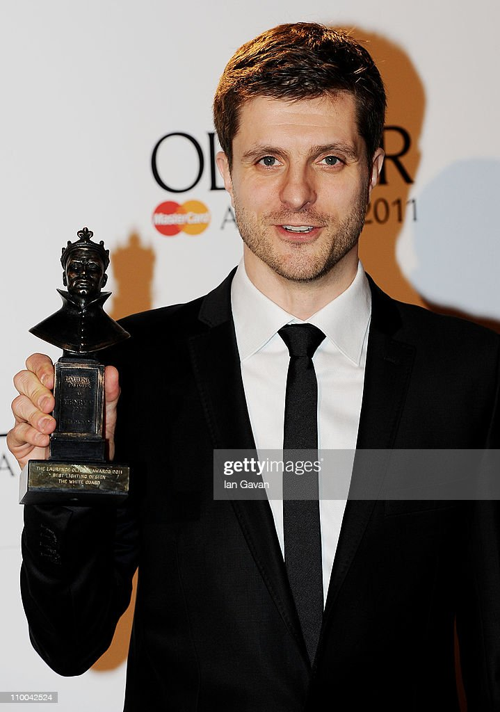 Neil Austin, winner of Best Lighting Designe for 'The White Guard' poses in the press room during The Olivier Awards 2011 at Theatre Royal on March 13, 2011 in London, England.