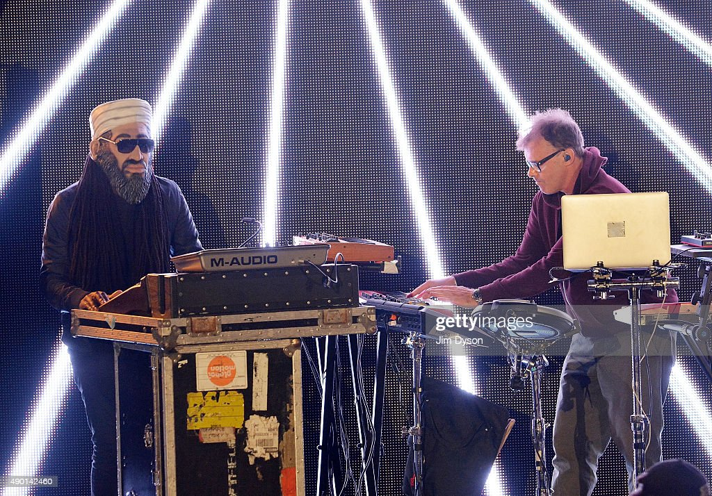 Neil Barnes (R) of Leftfield performs live on stage during the final weekend closing party of Dismaland on September 25, 2015 in Weston-Super-Mare, England. Graffiti artist Banksy opened the subversive, pop-up 'Bemusement Park' exhibition at the derelict seafront Tropicana lido for five weeks, attracting 150,000 visitors.