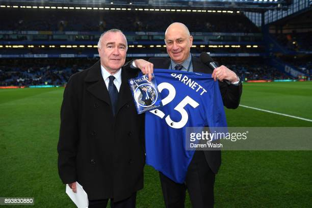 Neil Barnett, Chelsea match presentor is presented with a shirt by Ron Harris during the Premier League match between Chelsea and Southampton at...