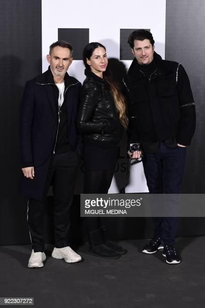 Neil Barrett Benedetta Mazzini and Corto Moltedo pose upon their arrival to the women's Fall/Winter 2018/2019 collection fashion show by Moncler in...