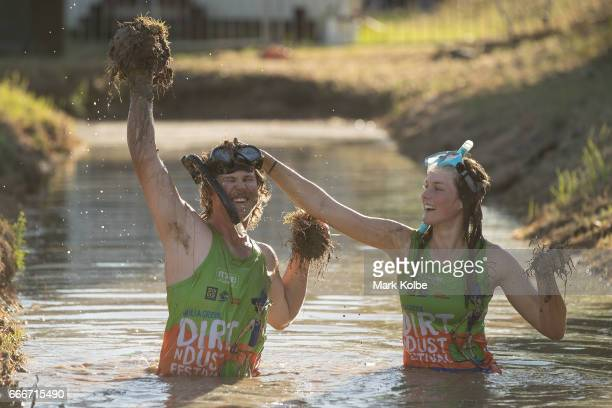Neil Batt and Aimie Athorn cover each other in mud during a media opportunity at the bog snorkelling pit at the Dirt 'n' Dust Festival 2017 on April...