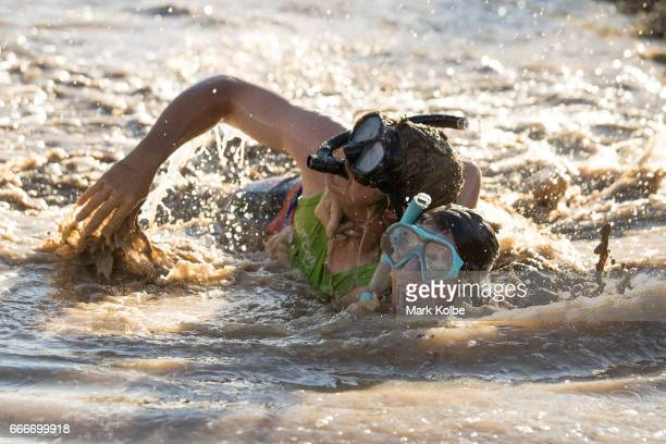 Neil Batt and Aimie Athorn race during a media opportunity at the bog snorkelling pit at the Dirt 'n' Dust Festival 2017 on April 8 2017 in Julia...
