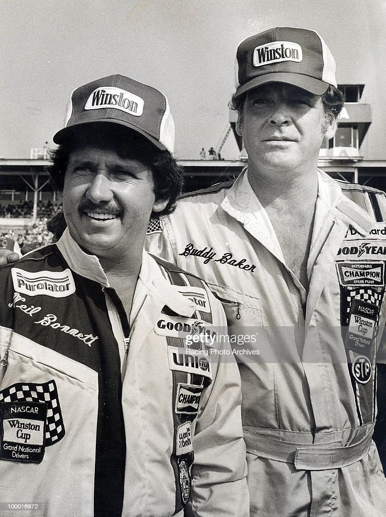 Neil Bonnett and Buddy Baker take a few photos before starting the Daytona 500. Baker would finish 4th and take home $35,740 while Bonnett would finish 33rd taking home $10,625 for the race.