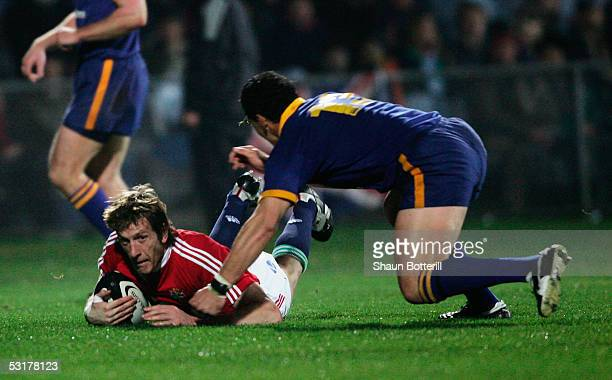 Neil Brew of Otago dives in with a late tackle as Will Greenwood of the Lions scores a try during the match between Otago and the British and Irish...