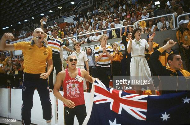 Neil Brooks and Greg Fasala of Australia part of the 'The Mean Machine' swimming team encourages their team during the Commonwealth Games held in...