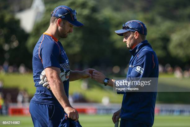 Neil Broom and coach Mike Hesson of New Zealand speak during day two of the test match between New Zealand and South Africa at Basin Reserve on March...
