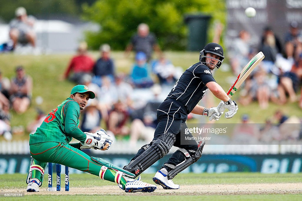 Neil Broom of New Zealand bats as wicketkeeper Nurul Hasan Sohan of Bangladesh looks on during the third One Day International match between New Zealand and Bangladesh at Saxton Field on December 31, 2016 in Nelson, New Zealand.