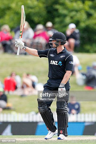 Neil Broom of New Zealand celebrates after reaching a half century during the third One Day International match between New Zealand and Bangladesh at...