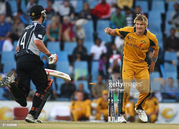 Neil Broom of New Zealand is run out by Shane Watson of Australia during the ICC Champions Trophy Final between Australia and New Zealand played at...
