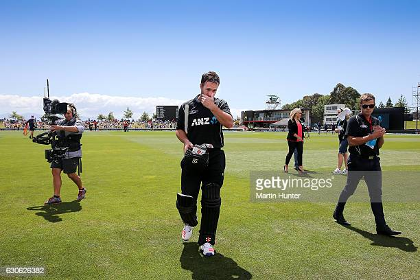 Neil Broom of New Zealand leaves the field after reaching a century during the second One Day International match between New Zealand and New Zealand...