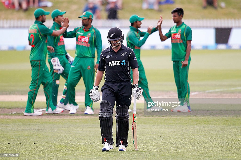 Neil Broom of New Zealand leaves the field as Bangladesh players celebrate during the third One Day International match between New Zealand and Bangladesh at Saxton Field on December 31, 2016 in Nelson, New Zealand.
