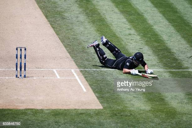 Neil Broom of New Zealand makes a dive to the crease during game three of the One Day International series between New Zealand and Australia at...