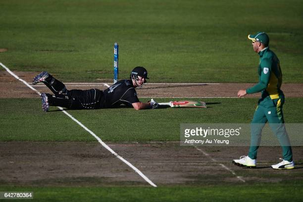 Neil Broom of New Zealand reaches his crease to avoid a run out during the First One Day International match between New Zealand and South Africa at...