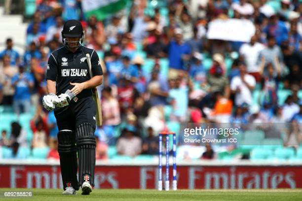 Neil Broom of New Zealand walks off dejected having been bowled off by Mohammed Shami of India for a golden duck during the ICC Champions Trophy...