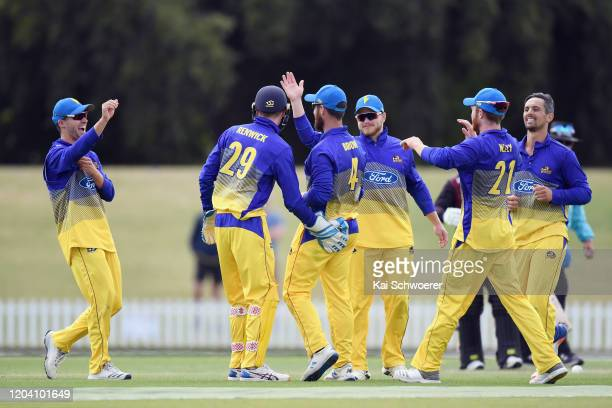 Neil Broom of Otago is congratulated by team mates after dismissing Stephen Murdoch of Canterbury during the Ford Trophy match between Canterbury and...