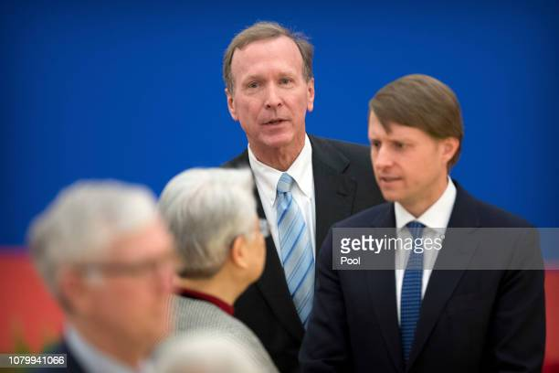Neil Bush center son of former US President George HW Bush attends an event commemorating the 40th anniversary of the establishment of diplomatic...
