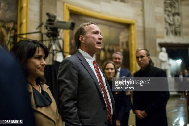 Neil Bush thanks visitors at the Capitol Rotunda as former US President George HW Bush lies in State on December 3 2018 in Washington DC A WWII...