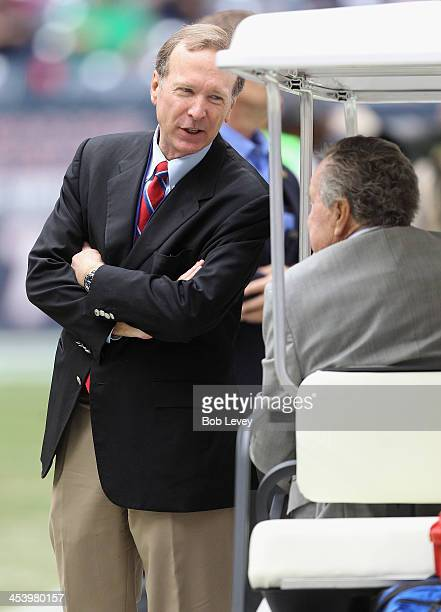 Neil Bush with his father President George HW Bush at Reliant Stadium on December 1 2013 in Houston Texas