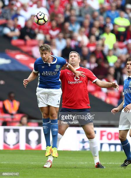 Neil Byrne of Macclesfield Town heads the ball away from Jon Parkin of York City during The Buildbase FA Trophy Final between York City and...