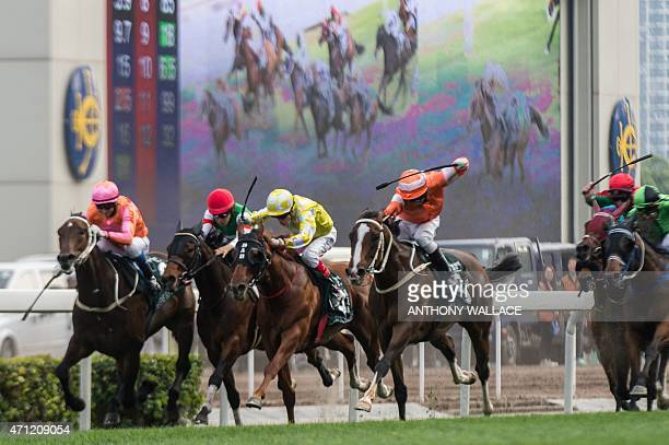 Neil Callan riding Blazing Speed uses his riding crop as they near the finishing post to win the 2015 Queen Elizabeth II Cup horse race at the Sha...