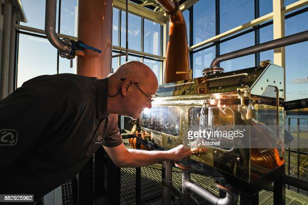 Neil Carlton senior distillery operator looks in the spirit safe in the still house at the new Clydeside Distillery on November 30 2017 in Glasgow...