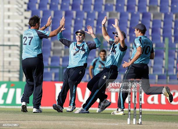 Neil Carter of Scotland celebrates with teammates after dismissing Stephan Myburgh of the Netherlands during Quarter Final match 66 between Scotland...