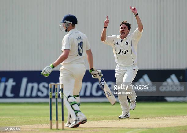 Neil Carter of Warwickshire celebrates dismissing Alex Blake of Kent during day three of the LV County Championship match between Warwickshire and...