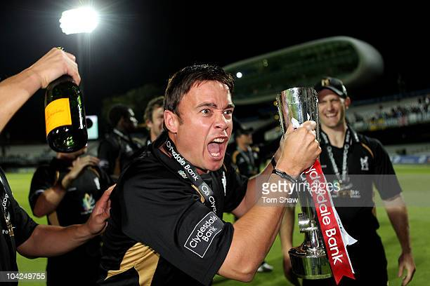 Neil Carter of Warwickshire celebrates with the trophy during the Clydesdale Bank 40 Final match between Somerset and Warwickshire at Lord's Cricket...