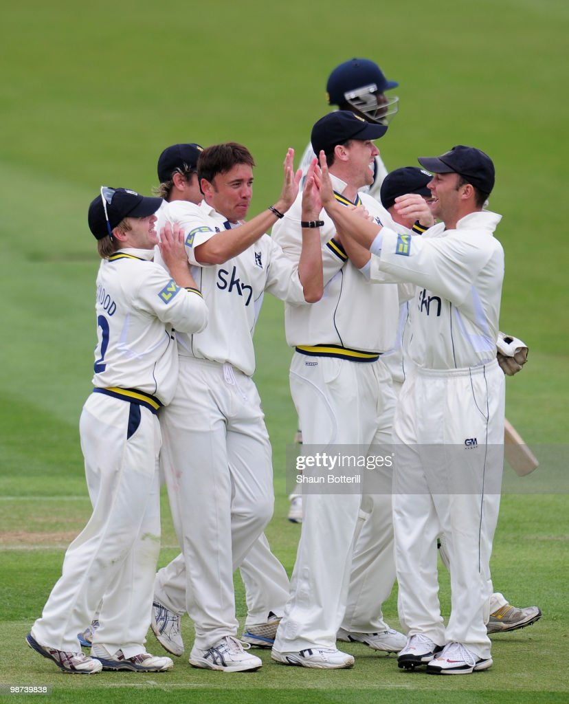 Neil Carter of Warwickshire is congratulated by team-mates after taking the wicket of Michael Carberry of Hampshire during the LV County Championship match between Warwickshire and Hampshire at Edgbaston on April 29, 2010 in Birmingham, England.