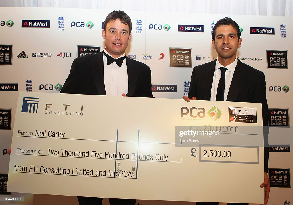 Neil Carter of Warwickshire (L) with the Reg Hayter Cup for the NatWest PCA Player of the Year presented by Vikram Solanki of the PCA during PCA Awards dinner at the Hurlingham Club on September 23, 2010 in London, England.