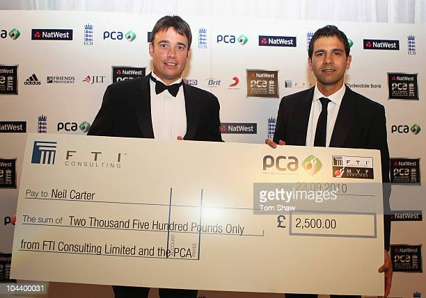 Neil Carter of Warwickshire with the Reg Hayter Cup for the NatWest PCA Player of the Year presented by Vikram Solanki of the PCA during PCA Awards...